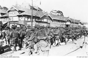 Men of the 18th Battalion waiting at the wharf to embark on the troopship A40 HMT Ceramic
