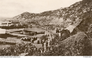 Stores, limbers and soldiers on Anzac Beach at Anzac Cove